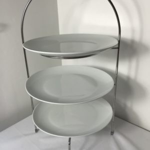 Trio of white plates on cake stand for hire